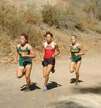 Rio Mesa Freshmen Elisse Weinerth challenging two MoorPark runners at Mission Oaks Park